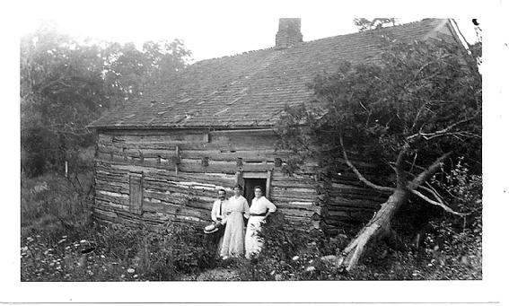 Hendrick (Henry) Wyckoff brought his family from Readington, NJ in 1798, to Black River, later known as Chester.  Many generations of the Wyckoff family lived in this log home and farmed the land and descendents of the family are still in Chester today.  Originally this log home belonged to minuteman John Emmons who had owned and farmed many acres in this area south of Chester near the intersection of Lamerson Road and Route 206.  Pictured in front of the cabin are members of the Howell family who were friends visiting.  All that is left on this site are foundations and this spring.  It has been noted in a letter in the Washington�s Headquarter Museum Library in Morristown, NJ that Washington himself had stayed in a log house one mile south of Chester.  It is believed to have been this log cabin.